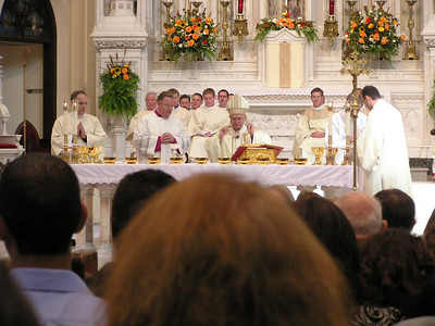 Oct 9, 2010, Denver Archdiocese Cathedral, The two newly ordained Deacons assisting Archbishop Chaput at Mass.