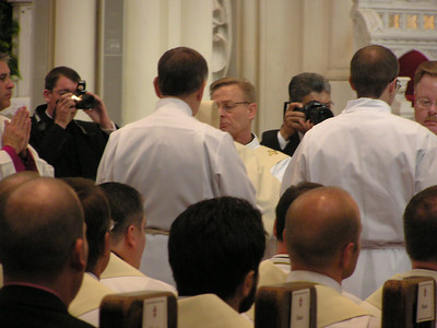 Oct 9, 2010, Denver Archdiocese Cathedral, Mike Bodzioch being vested by Deacon Jim Devlin.