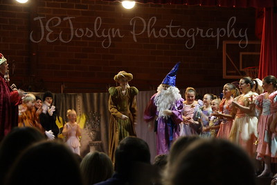 GD2-November 2009 FairyTale Play at School.  Very dark photograph, but I liked this one because of all the HEADS watching the children.