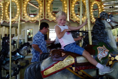 Young rider on Cafesjian's Carousel in Como Park, St. Paul, Minn.
