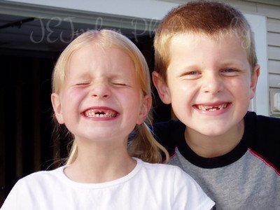 Cousins, how fun to lose teeth, when young, of course.  May, 2005 (P,A)