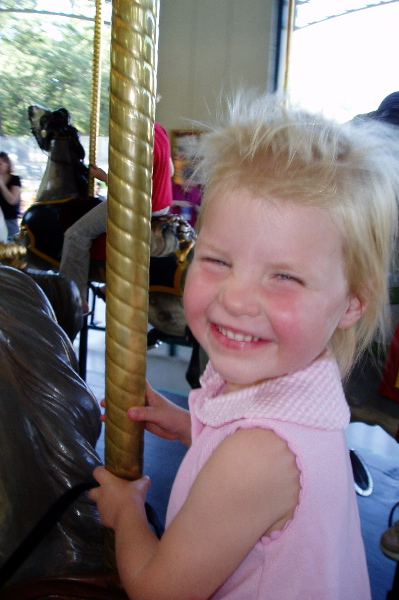Young rider on Cafesjian's Carousel in Como Park, St. Paul, Minn., GD-2 is 4 years old, 2004.