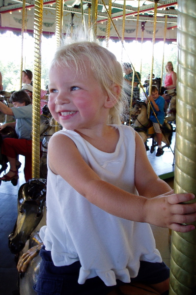 Young rider on Cafesjian's Carousel in Como Park, St. Paul, Minn., 2 1/2 years old, 2004.