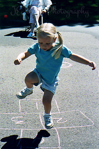HopScotch while visiting auntie A's house, summer, 2005.  Age, 3 1/2 (C).