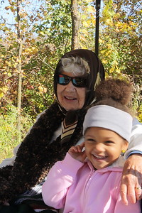 GD-4 and Great Grandmother Lois Prior Joslyn at Elm Creek, Maple Grove, MN, Tram Ride through the park on October 3, 2010.  Sunshine, and colored leaves at their best.  Very beautiful.