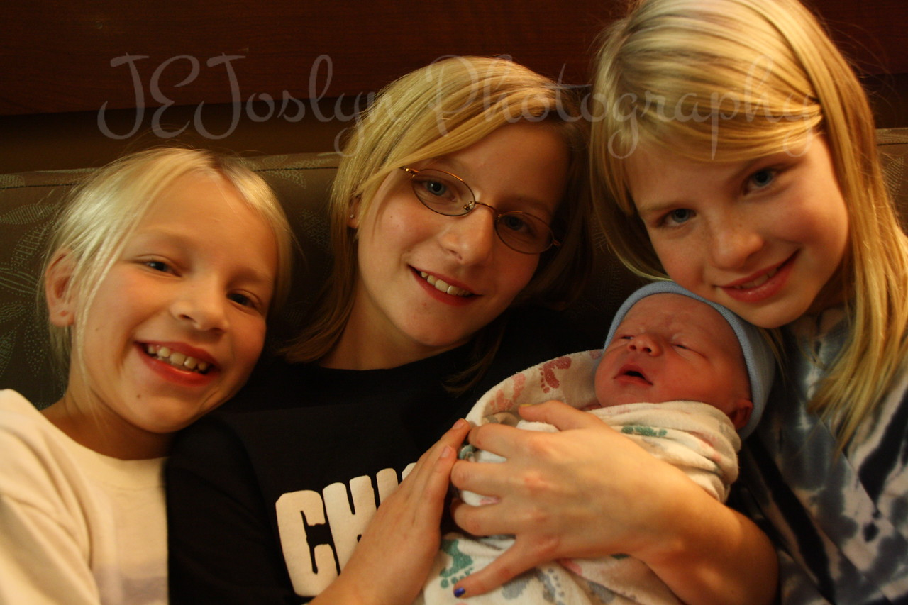 KPJ, GS-2, born November 17, 2010, 4:30 p.m.  Sisters and their new brother.