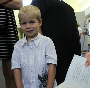 Roman at Allen's funeral.