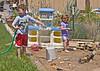 Making mud in back yard, Vernal, 5-30-08