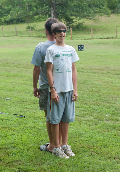 July 31, 2010:  At farm, comparing heights with Ben.