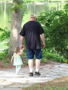 Corynna walking with Grandpa