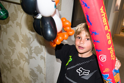 Grant with his penguin and inflatable hammer.