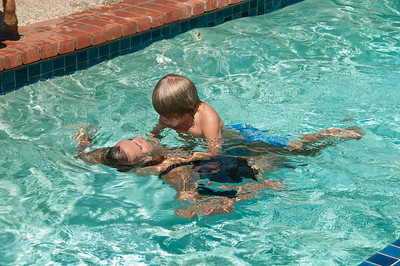 Grant swims with mom.