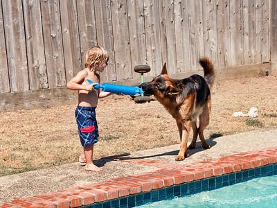 Water toy plus Monty, Saxon has some wet fun.