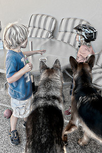 Snack Time rendered as a sketch. The boys and two very attentive dogs.
