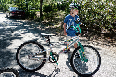 """Grant and his new bike with 20"""" wheels."""