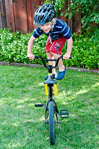 Trick Rider - Grant balances on his front wheel.