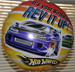 Grant gets a birthday balloon featuring his favorite things! Not hot wheels but cars.