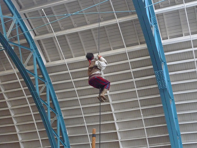 A crew member climbs the rope.
