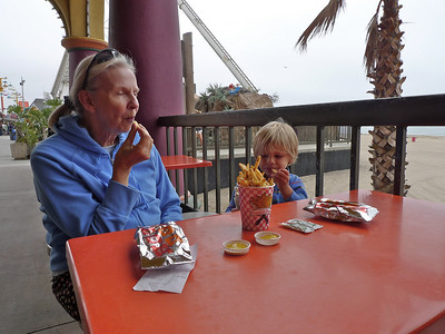 Enjoying a hot dog, fries and some ice cream.