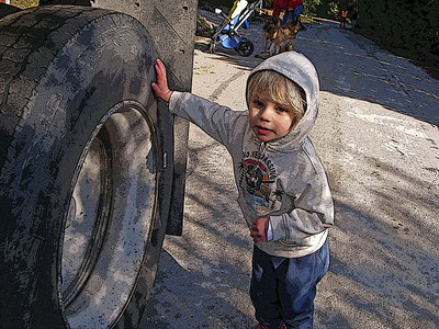 The tire is bigger than I am.