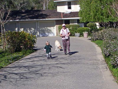 """G"" and his Farmor walk up the driveway after meeting Skittles and giving her some cookies."