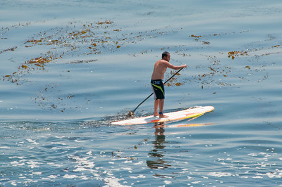 A paddler on his way out to catch some waves.