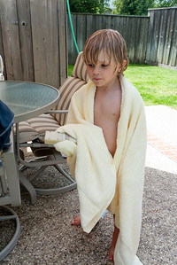 Towel and controller for the hot tub, ready for action.