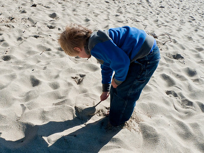 Drawing in the sand.