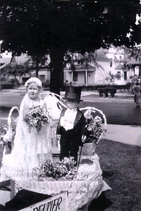 Beverly Spear and Walter Spear on a float for a Mt. Clemens, Michigan parade, the clothing was made by their father.