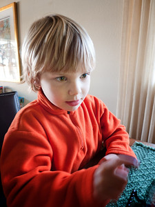 Pointing out action on the i-pad. (Leica D-Lux 4)