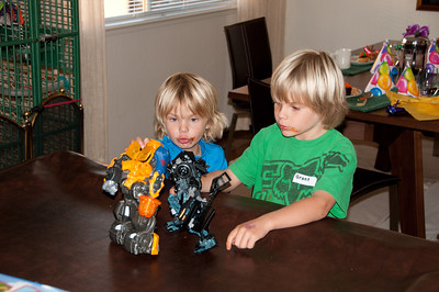 The boys try out the Transformers.
