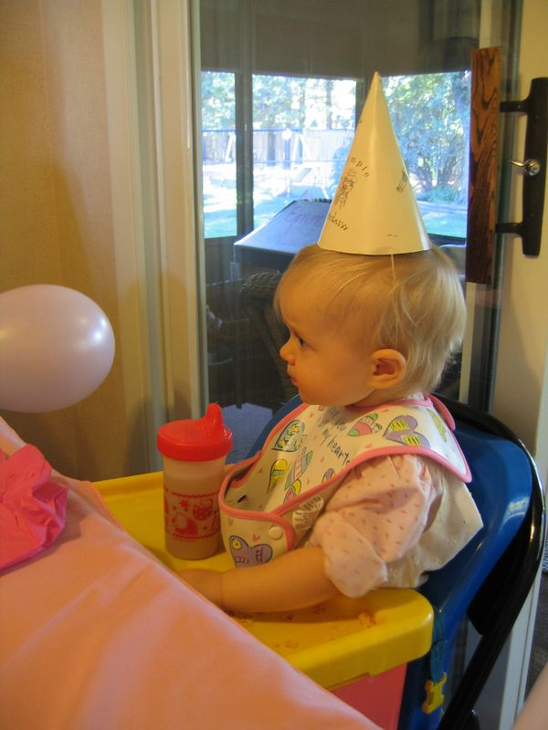 Emma wore the same dress that her mommy had worn on HER first birthday!