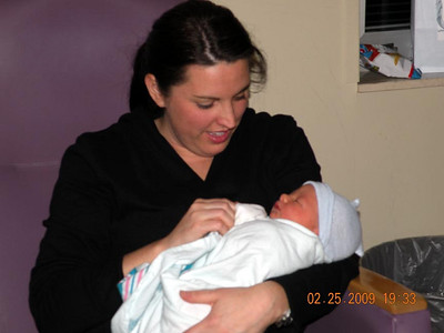 Laura holds baby Michael.
