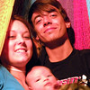 Ashley, Jared and Michael in the hammock on the back porch after supper. Buncha kids!
