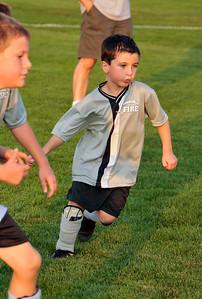 Going after the soccer ball, September 2009