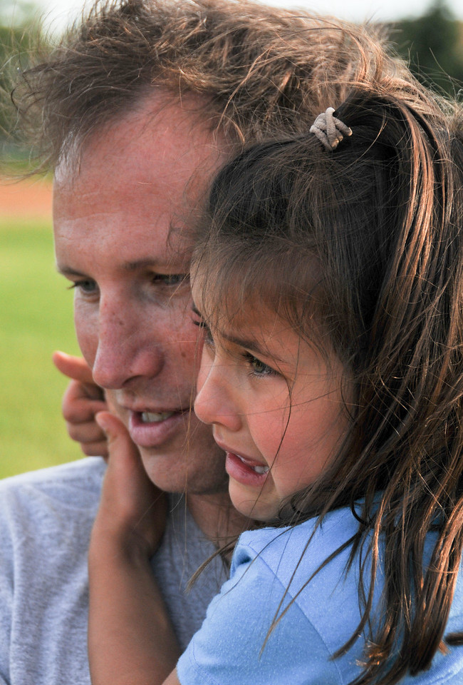 Dad and Chayse watch Carson's game, June, 2010
