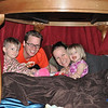 Nate & Malaika under table with Kendra & Rivka
