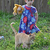 grandkids - Kendra in backyard with cat