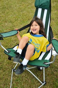 Chayse enjoys relaxing at one of Carson's soccer games