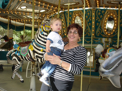 Grandma Lee took Lincoln on the carosel at the park.
