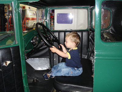 Driving an old Ford at the museum.