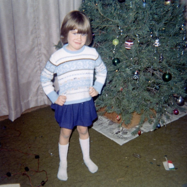 Christine trimming tree<br /> Quincy, Illinois<br /> Christmas 1970
