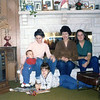 Mary, Jan and Chris sitting at the fireplace<br /> Natalie and Lisa below<br /> Quincy, Illinois<br /> Christmas 1979