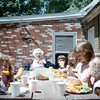 At Uncle Gary's with Grandma Rita at the head of picnic table<br /> 1989