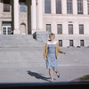 Sally running in front of the Park Bldg. to her Biology class nearby.