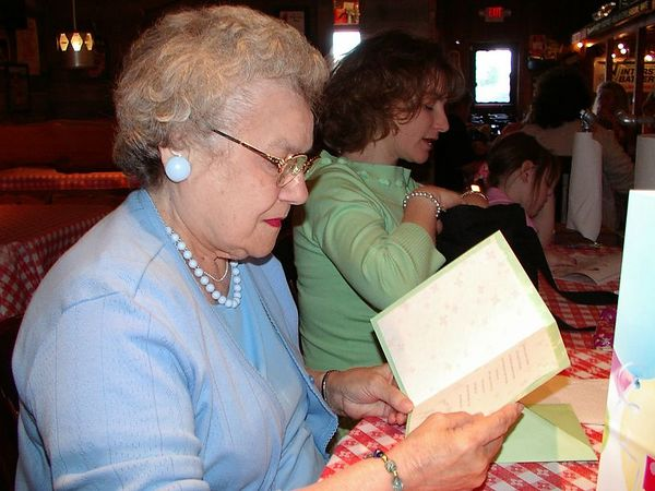<br><br><font size=3>Grandma reads a card.</font>
