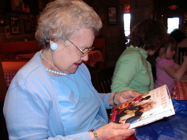 <br><br><font size=3>Grandma, checking out her new cookbook.</font>