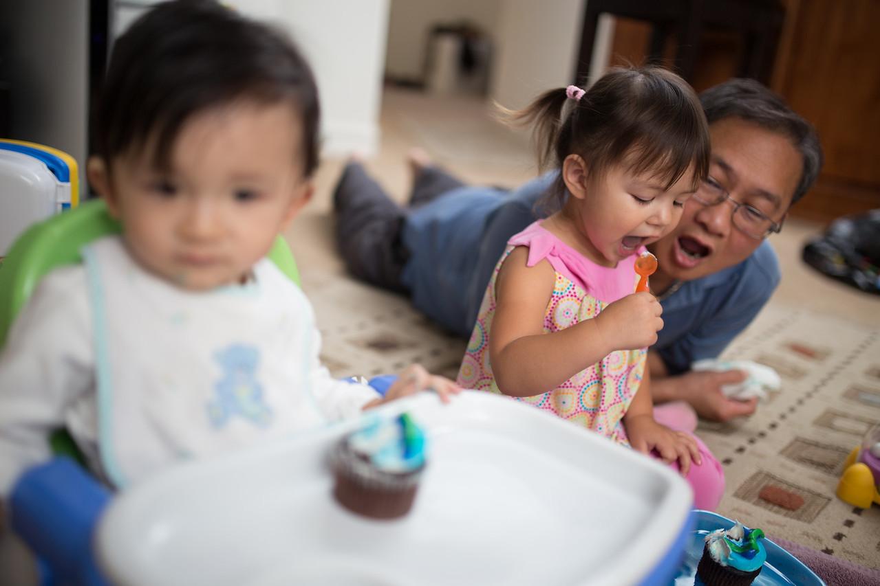 Remy and Grandpa Hai enjoy a cupcake.