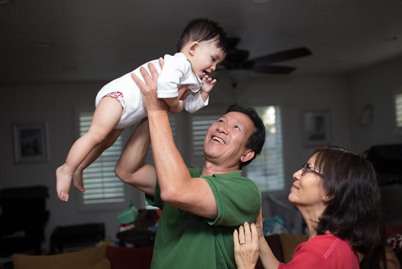 Grandpa Kim and Grandma Lan play with Noah