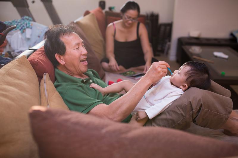 Grandpa Kim feeds Noah